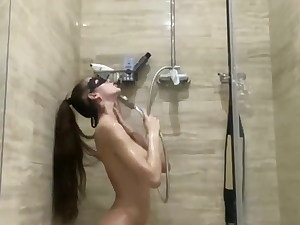 brunette with ample mammories washes in the douche