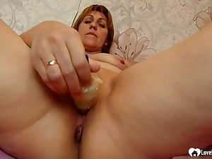 Sandy-haired mom uses a intercourse fucktoy on herself